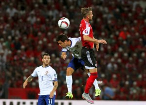 Albania's Lenjani jumps for the ball with Portugal's Silva during their Euro 2016 qualifying soccer match at Elbasan arena stadium in Elbasan
