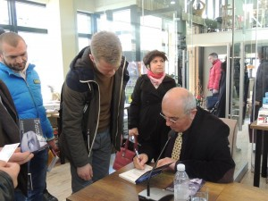 Besnik Mustafaj signs books for readers