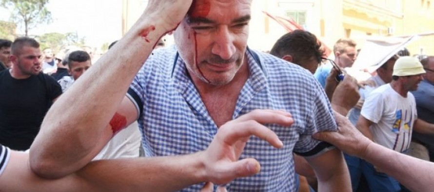 Opposition newspaper editor tells parliamentary hearing he was beaten by police at protest