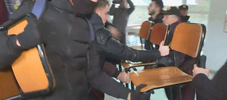 Students clash with police trying to continue protests inside faculties